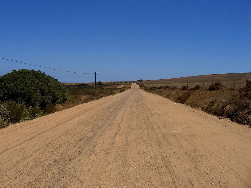 Route cutting across the Darling Farmlands off the main west coast R27 road north of Cape town, South Africa © Steve Ogden