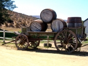 Cart and wine barrels outside Groote Post winery, Darling Hills,South Africa